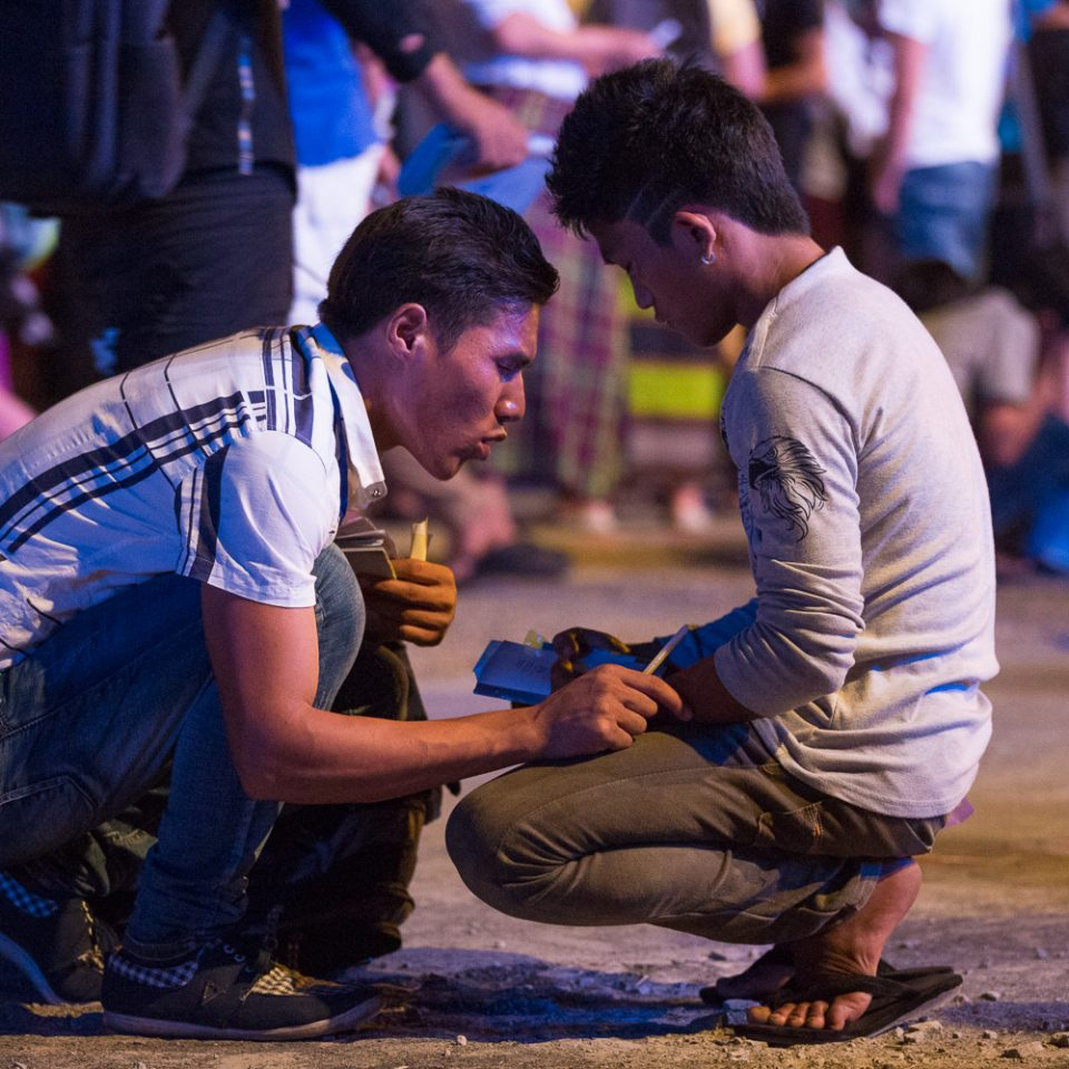 A trained counselor prays with a young adult who came forward after Franklin Graham led the crowd in a prayer of salvation.