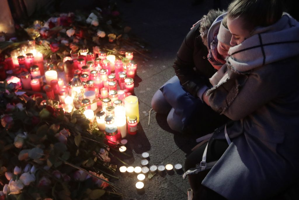 Two women mourn beside candles in Berlin, Germany, on Tuesday, the day after a truck ran into a crowded Christmas market nearby and killed 12 people. Crisis-trained chaplains with the Billy Graham Rapid Response Teams from Canada and the United States are deploying to minister alongside local churches. (AP Photo/Markus Schreiber)