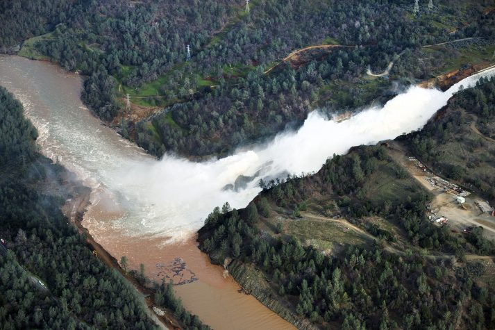 Water continued to run down the main spillway at Lake Oroville on Monday. The water level has dropped behind the nation's tallest dam, but officials are still cautious about the risk of a catastrophic spillway collapse.