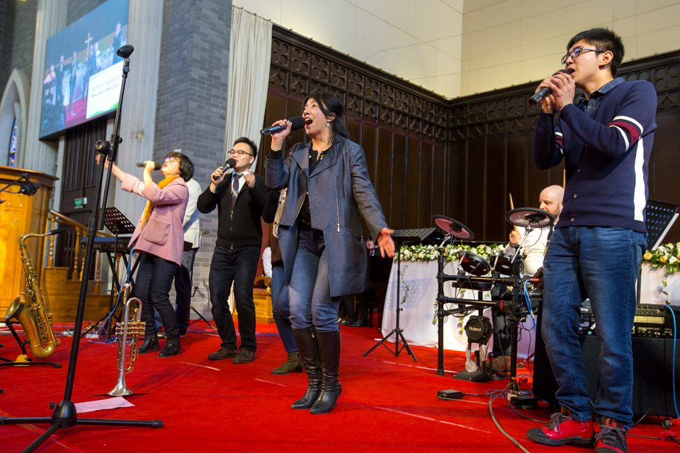 A local band leads praise and worship.