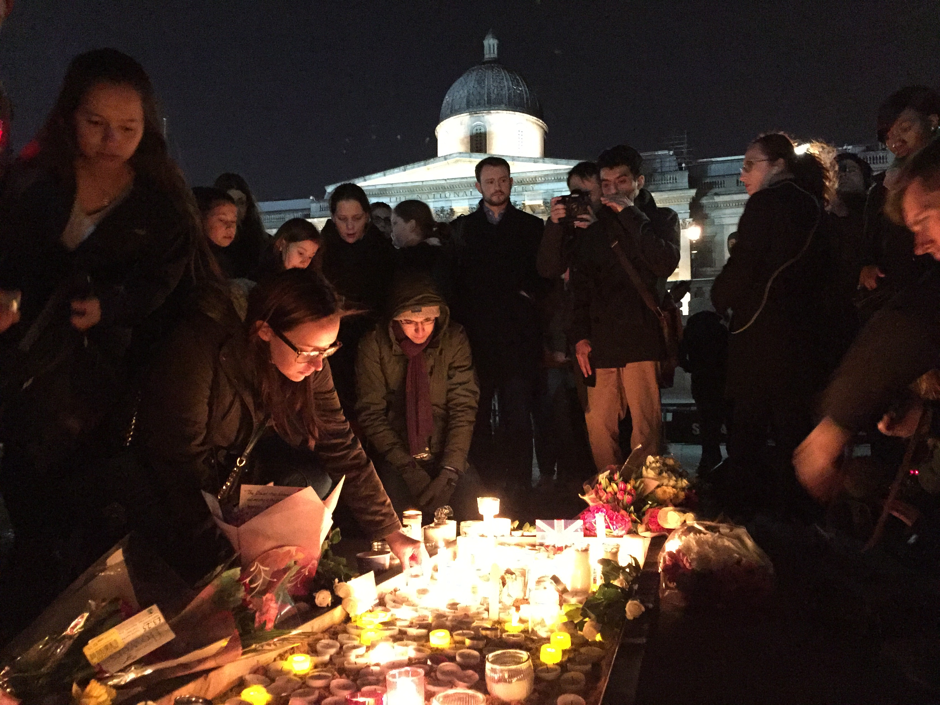 Grieving Londoners lay candles in Trafalgar Square